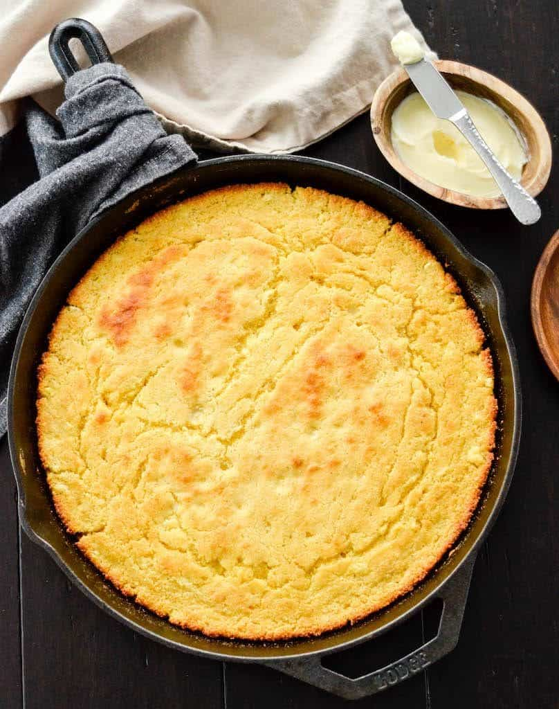 Overhead view of healthy skillet cornbread recipe in a cast iron skillet