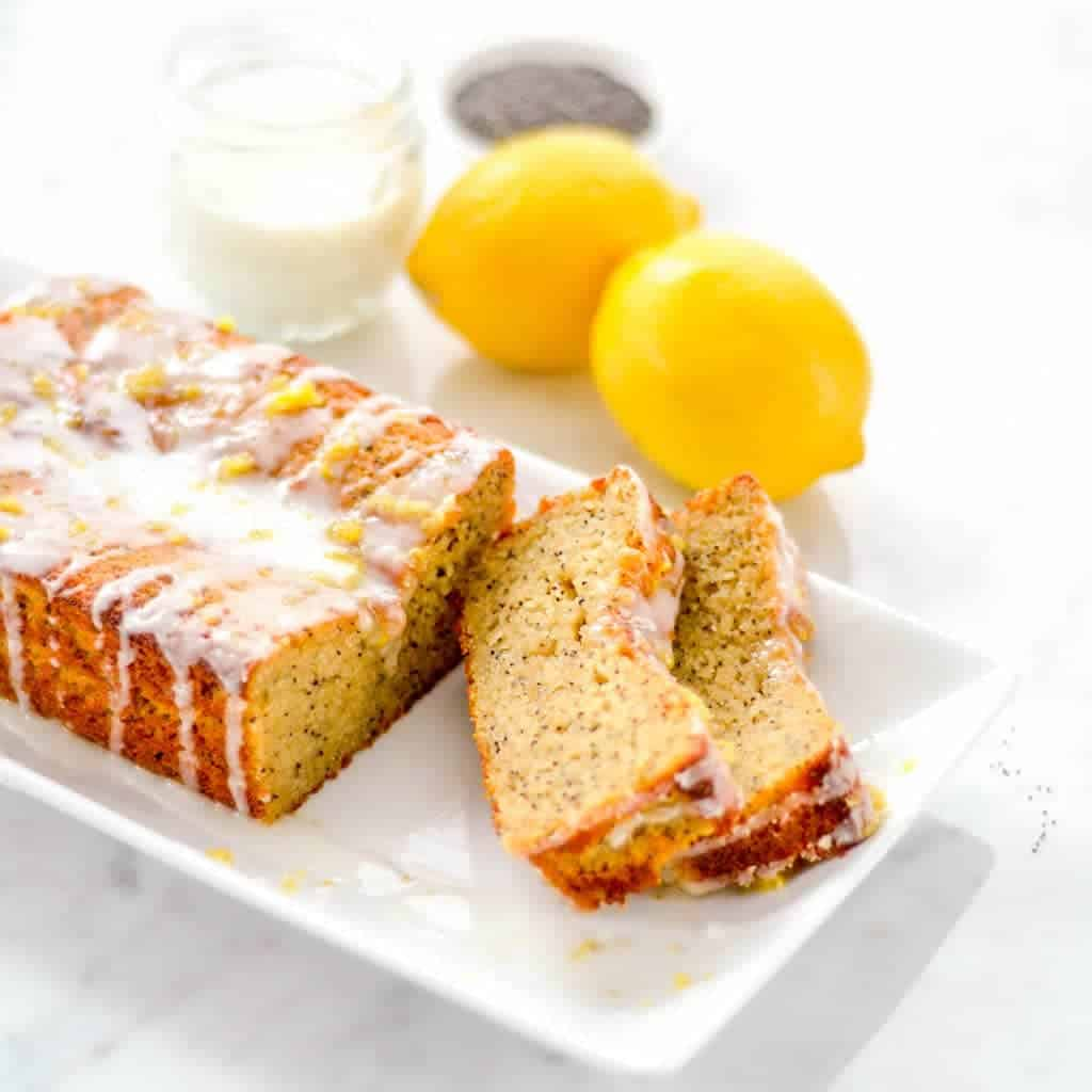 side view of a loaf of Paleo Lemon Poppyseed Bread with two pieces cut