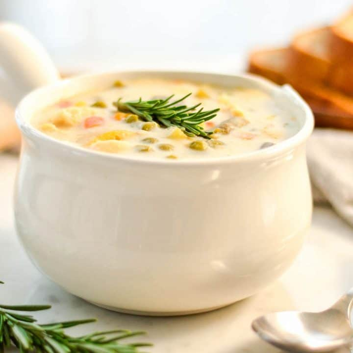 front view of Slow Cooker Chicken Pot Pie Soup in a white soup bowl