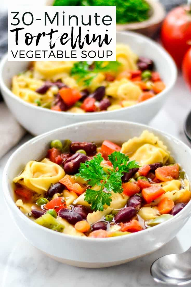 This Easy Tortellini Soup Recipe is an easy, healthy & delicious 30 minute dinner perfect for the busiest weeknights!  Full of vegetables and protein it's a great main dish recipe!  #tortellinisoup #easytortellinisoup #tortellini #soup #vegetablesoup