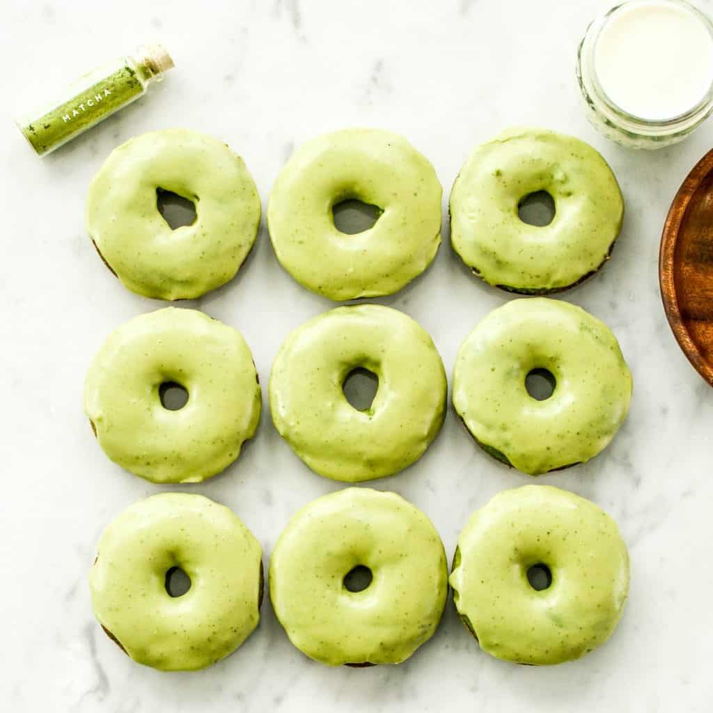 Baked Paleo Spinach Donuts with Matcha Glaze are the perfect healthy breakfast full of sneaky veggies! Gluten-free, dairy-free, and refined sugar free!
