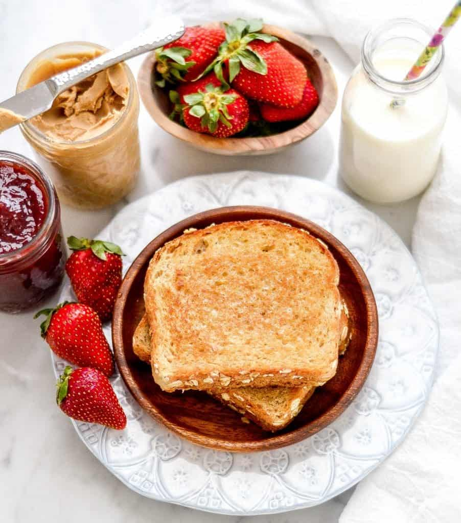 You will never eat a regular PB & J again after making these Grilled Peanut Butter & Jelly Sandwiches! This easy recipe uses only 4 ingredients and is perfect for lunch or those nights when you don't feel like cooking dinner! Vegan & Gluten-Free options!