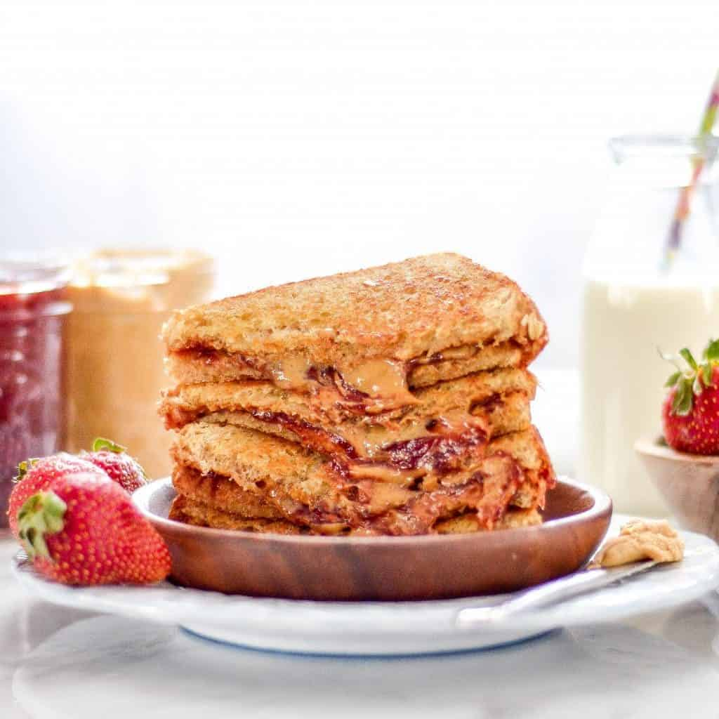 front view of a stack of four Grilled Peanut Butter and Jelly Sandwich Recipe halves