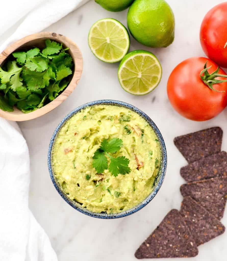 overhead view of a bowl of Easy Homemade Guacamole surrounded by chips