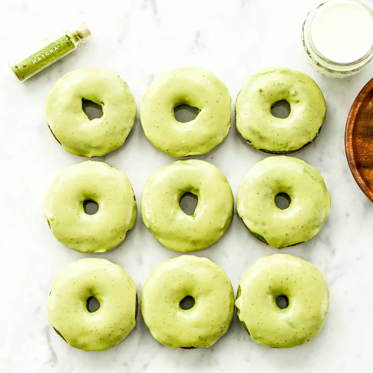 Overhead view of 9 Paleo Spinach Donuts arranged in 3 rows of 3