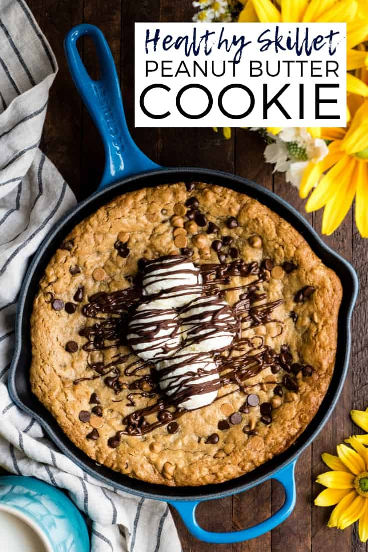This Healthy Skillet Peanut Butter Cookie is a chocolate and peanut butter lover's dream come true. A slightly under-baked, gooey dessert bursting with peanut butter and chocolate and given a healthy makeover! Gluten-free, dairy-free and refined sugar free! #skillet #cookie #peanutbutter #oatmeal #dessert #healthydessert #recipe