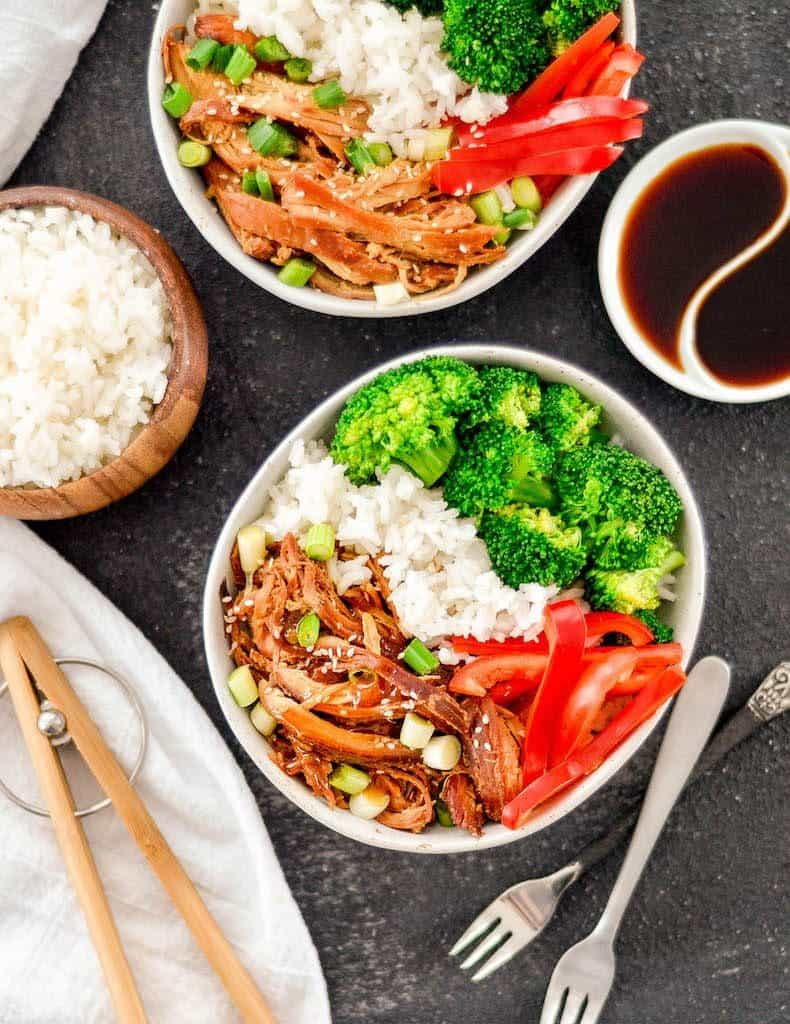 Overhead view of two bowls Slow Cooker Teriyaki Chicken with rice and vegetables