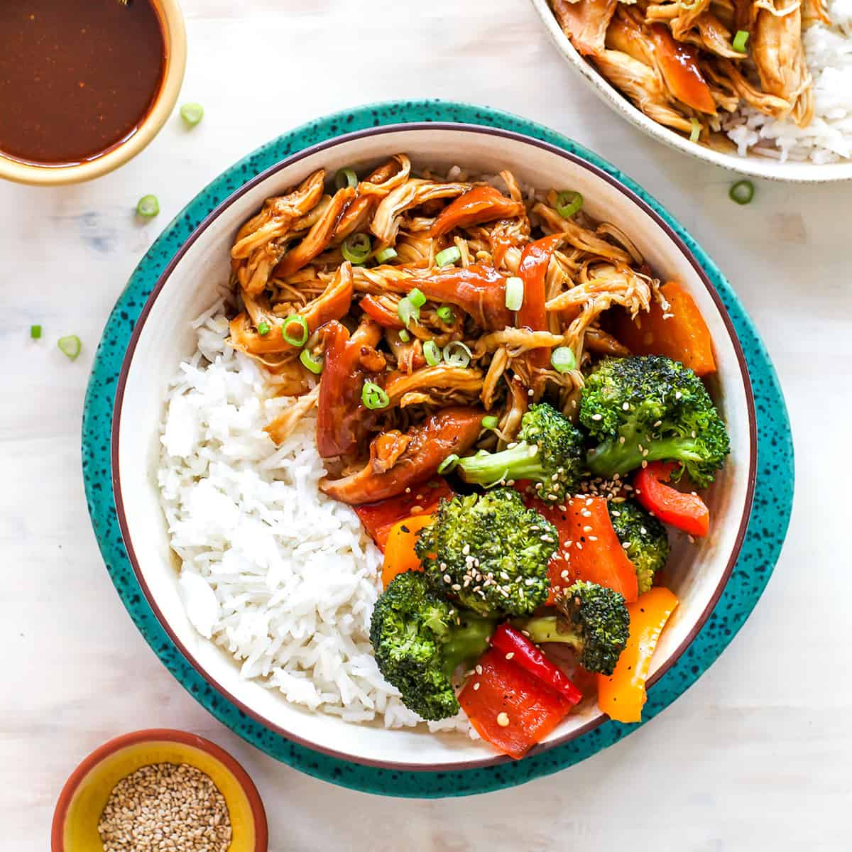 overhead view of a bowl of crockpot teriyaki chicken with veggies and rice
