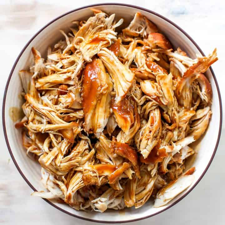 overhead photo of crockpot teriyaki chicken in a bowl