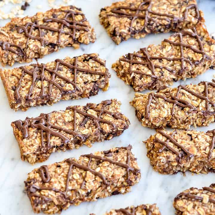 overhead view of 8 Homemade Peanut Butter Granola Bars recipe lined up in four rows and two columns