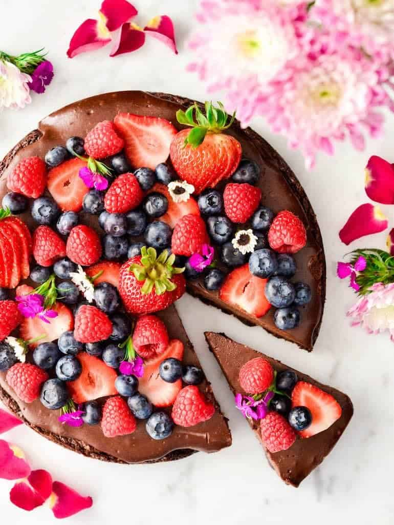 Overhead view of Paleo Chocolate Fruit Pizza with a slice cut out of it but still sitting in place
