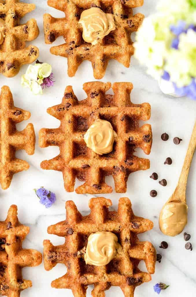Up close overhead view of peanut butter waffles with a dollop of peanut butter