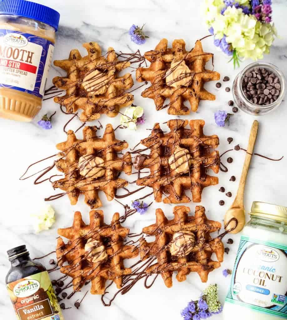 Overhead view of peanut butter waffles drizzled with chocolate