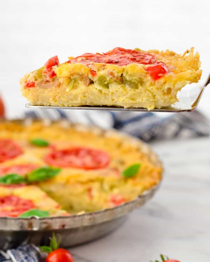 Side view of a one piece of Gluten-Free Hash Brown Quiche