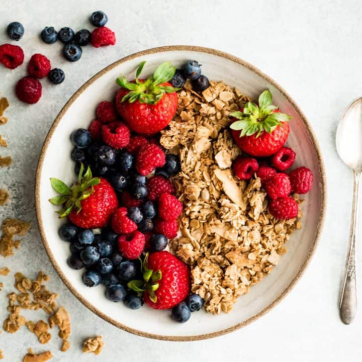 a bowl of Healthy Homemade Granola with berries