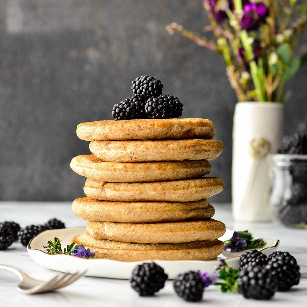 Front view of a stack of seven Fluffy Whole Wheat Pancakes
