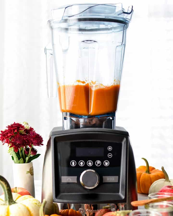 Front view of a vitamix blender with Homemade Apple & Pumpkin Baby Food puree inside