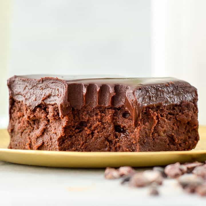 front view of a healthy brownie on a plate with a bite taken out of it