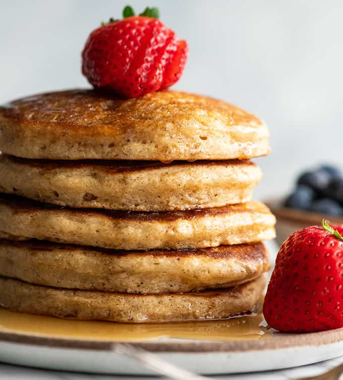 front view of a stack fo 5 whole wheat pancakes