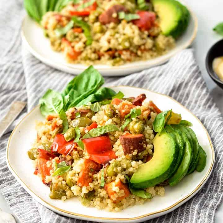 front view of two plates of Roasted Vegetable Quinoa Salada