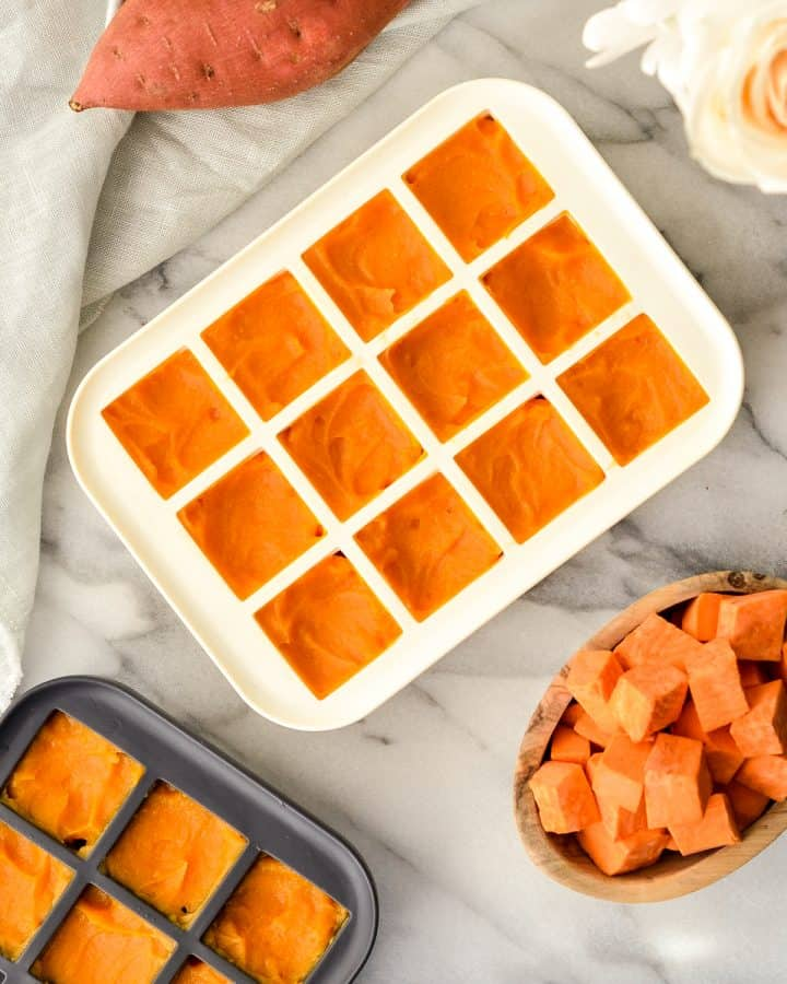 Overhead view of Sweet Potato Baby Food in silicone ice cube trays ready to be frozen