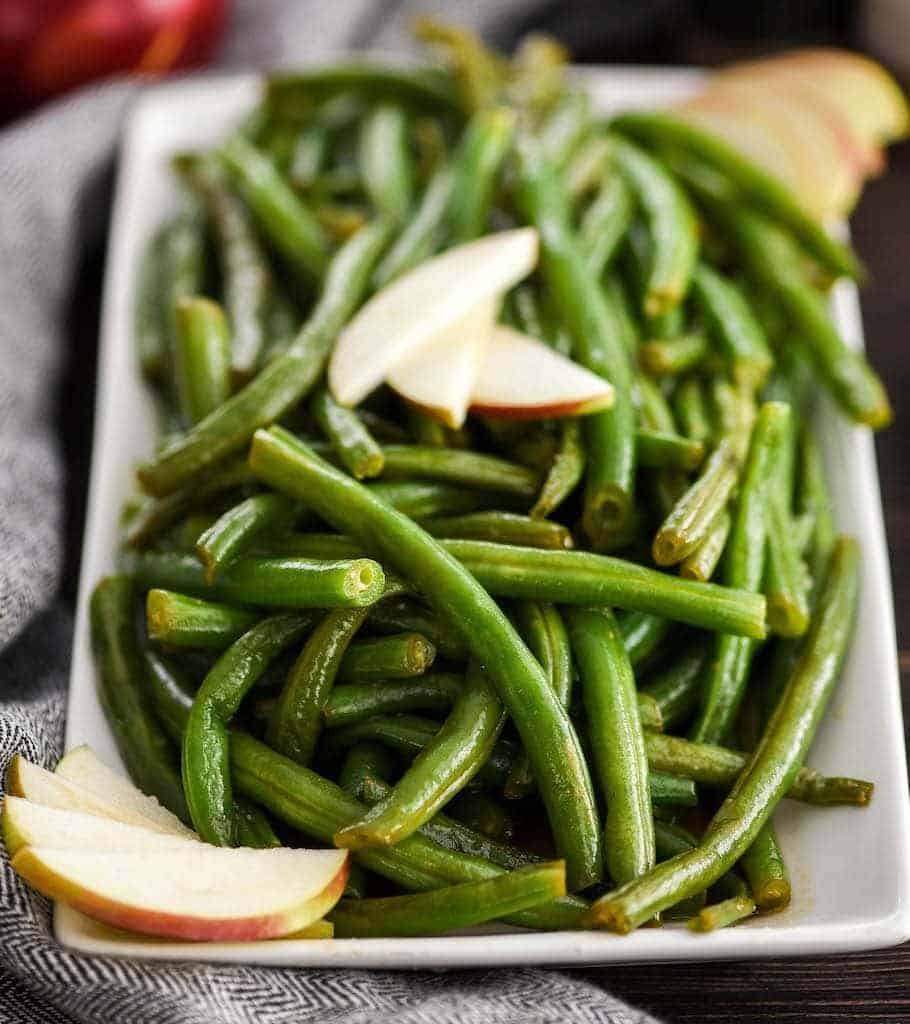 front view of a serving dish of Sautéed Green Beans Recipe with Apple Cider