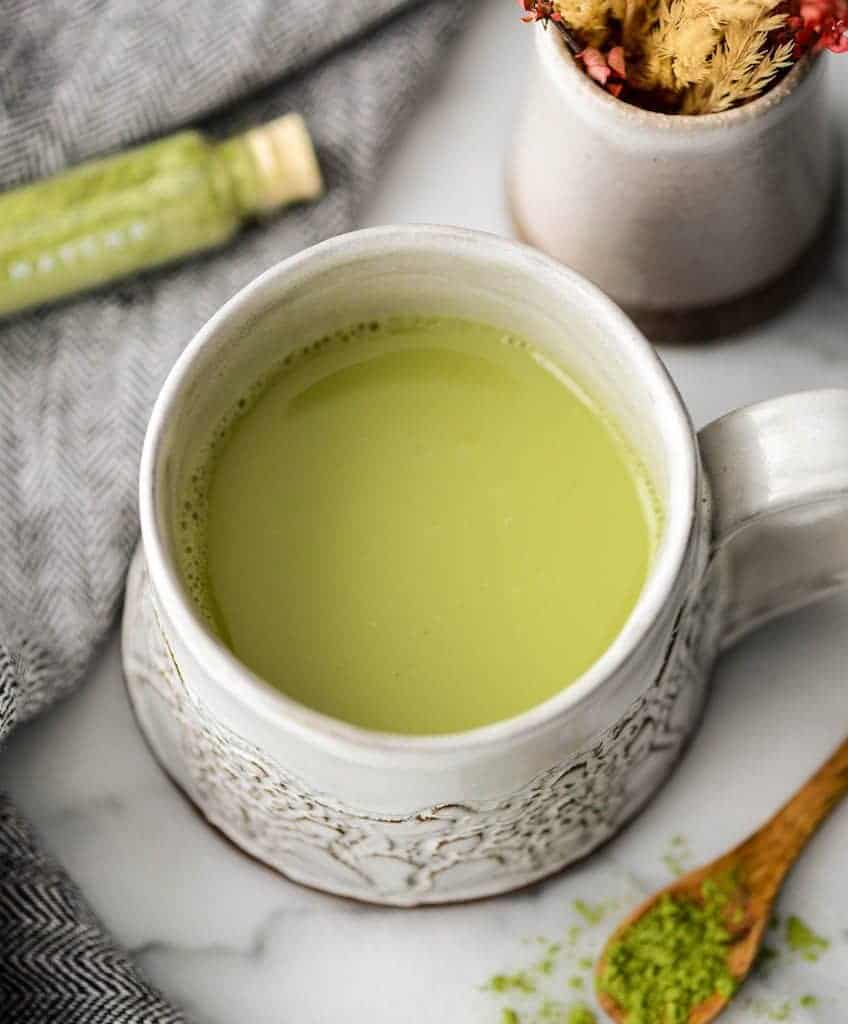overhead view of Collagen Matcha Latte Recipe in a mug