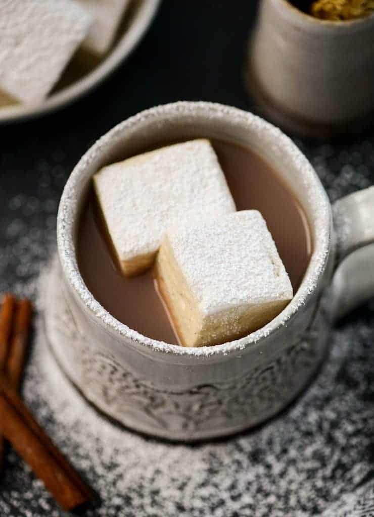 Overhead view of two Homemade Marshmallows in a mug of hot chocolate