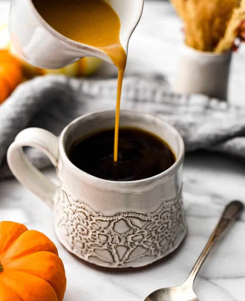 Front shot of Pumpkin Coffee Creamer being poured into a mug of coffee