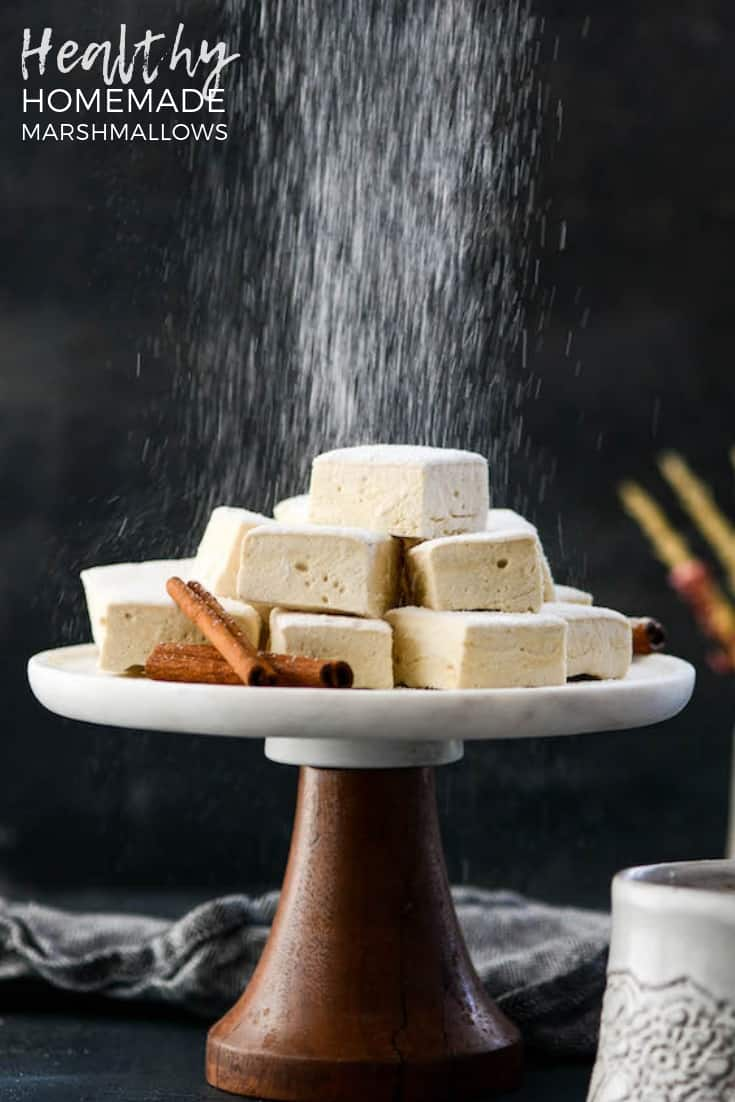 This easy, healthy homemade marshmallows recipe will cause you to kiss store bought mallows goodbye. They're paleo, gluten-free, dairy-free, refined sugar free and insanely delicious! #homeamde #marshmallows #paleomarshmallows #nocornsyrup