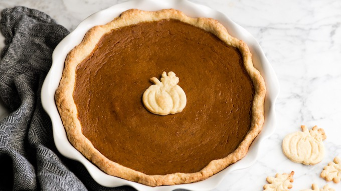 overhead view of a pumpkin pie in a white pie dish