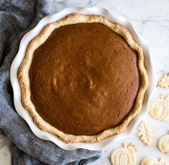 overhead view of the best pumpkin pie recipe in a white pie dish after baking