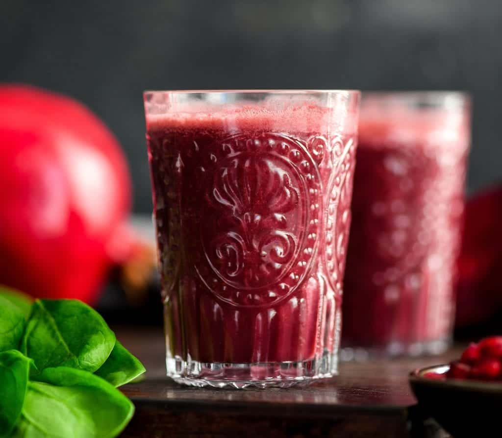 This Beet & Pomegranate Smoothie with Spinach is a beautiful and healthy breakfast recipe that utilizes the best winter produce! It's paleo, & vegan with no refined sugar!