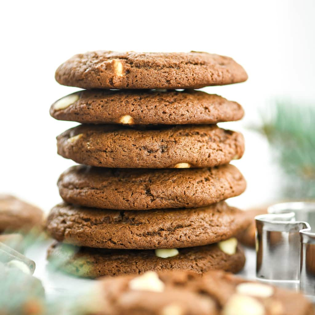 Front view of a stack of six White Chocolate Chip Gingerbread Cookies