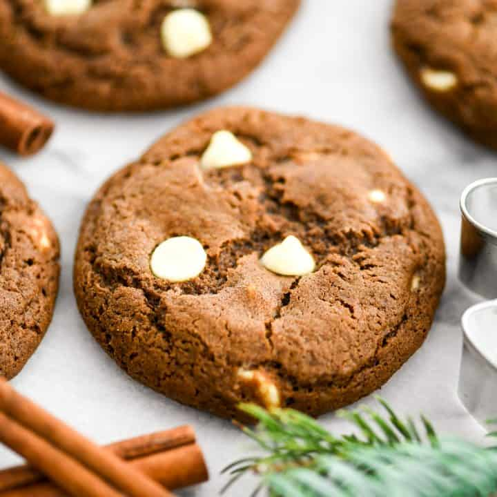 one white chocolate gingerbread cookie surrounded by 3 others