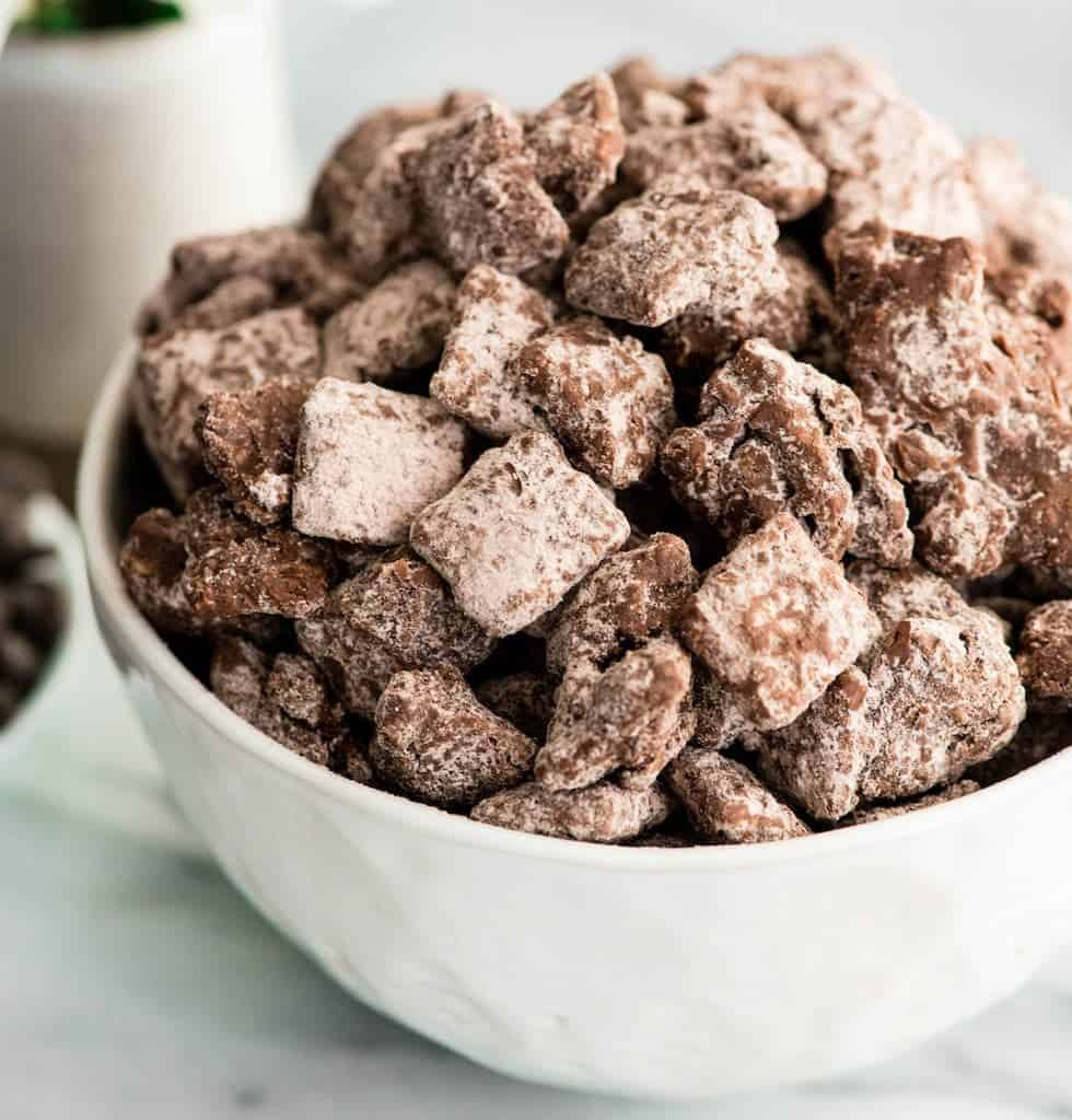Side view of a bowl ofDark Chocolate Puppy Chow