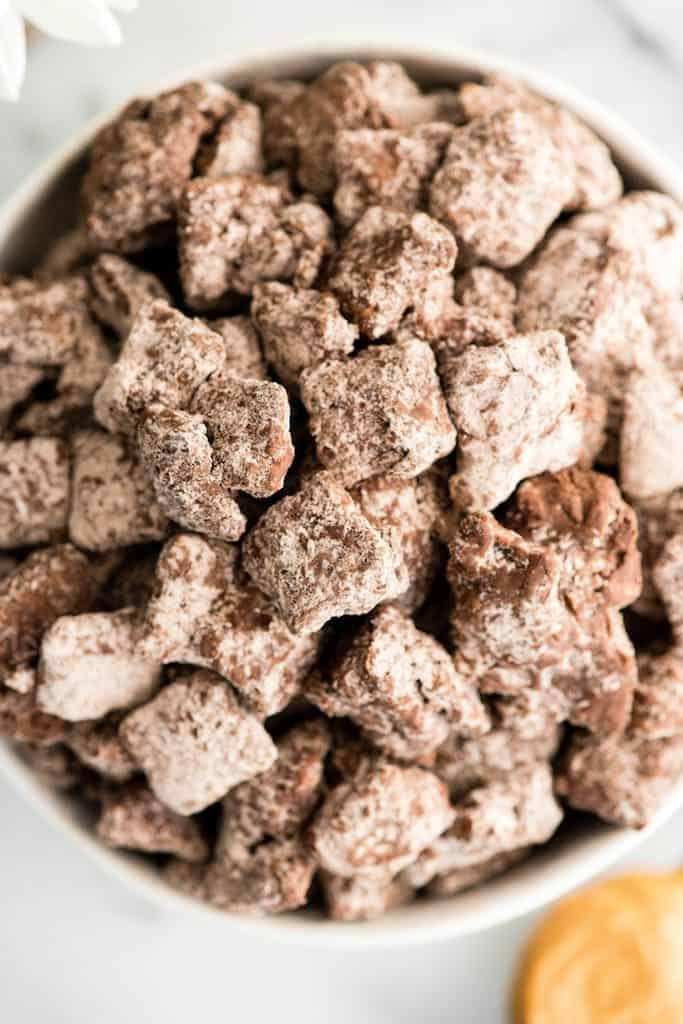 Up close overhead view of a bowl of Dark Chocolate Puppy Chow aka: Muddy Buddies