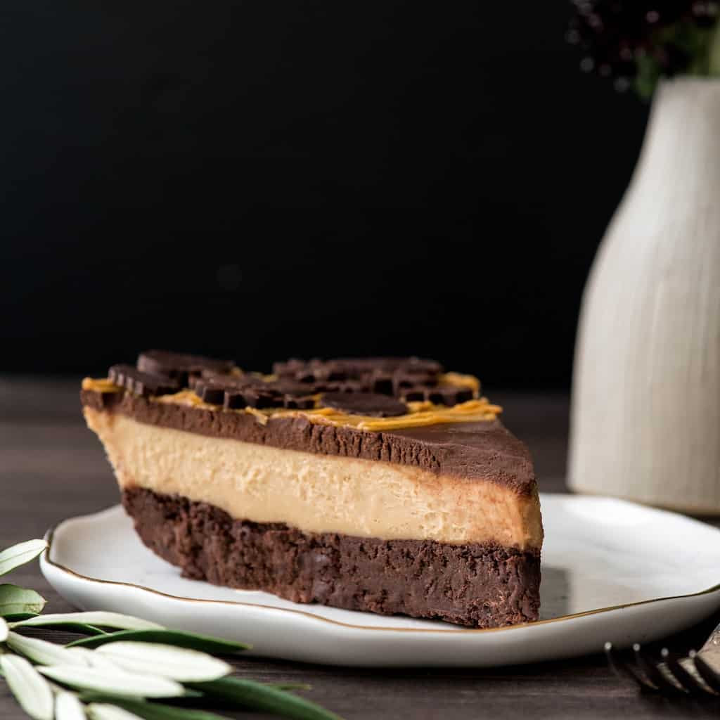 Side/front view of a slice of chocolate peanut butter pie on a plate