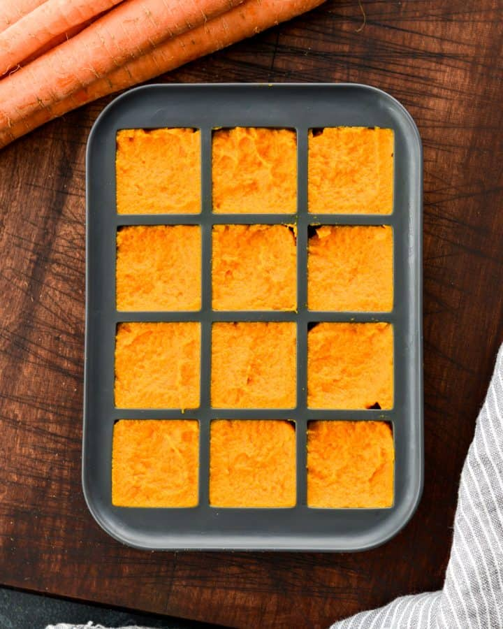 Overhead view of Homemade Baby Food Carrots puree in a silicone ice cube tray