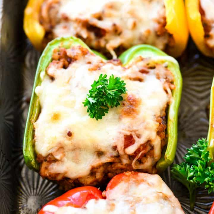 Healthy Italian Stuffed Peppers on a baking pan with parsley on top