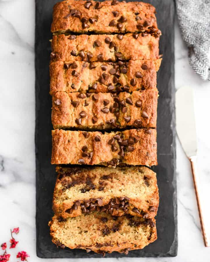 a loaf of paleo banana bread cut into 7 pieces