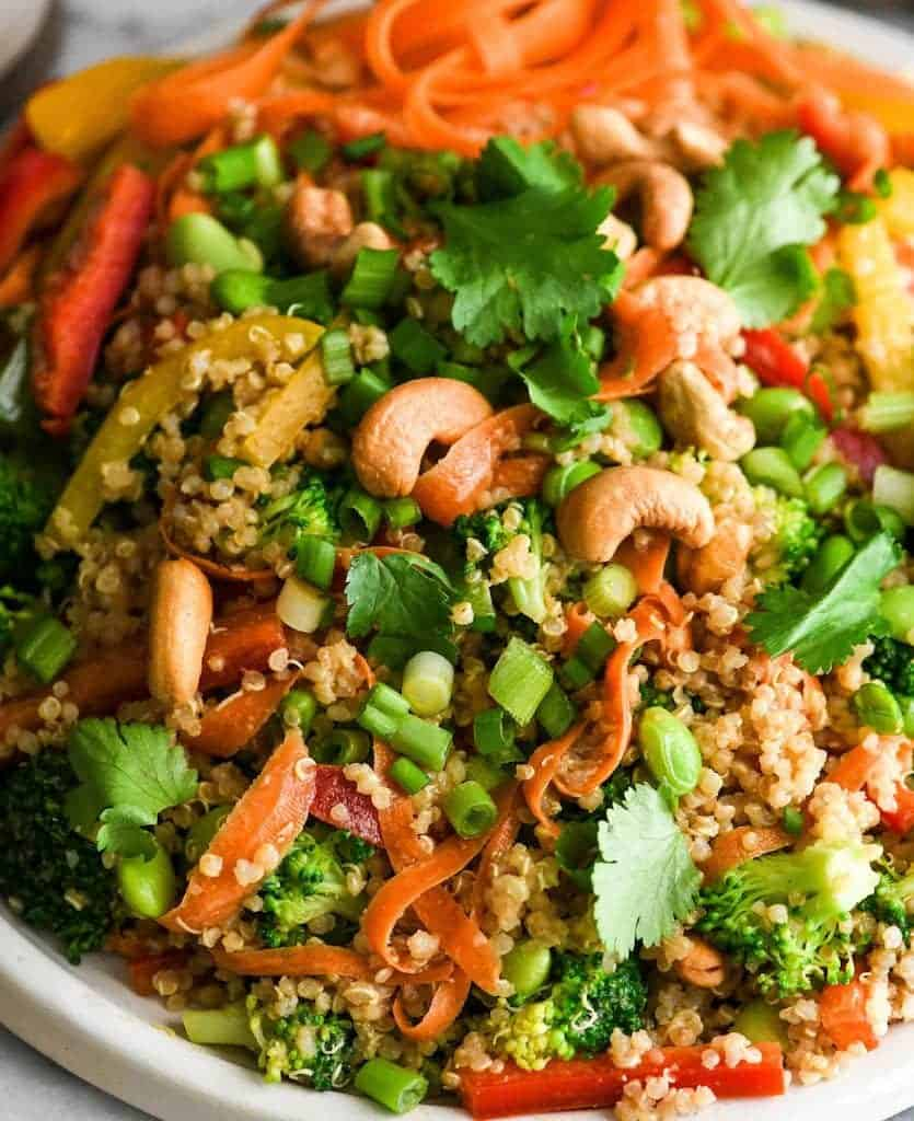 Up-close, angled overhead view of Asian Quinoa Salad with Peanut Dressing recipe