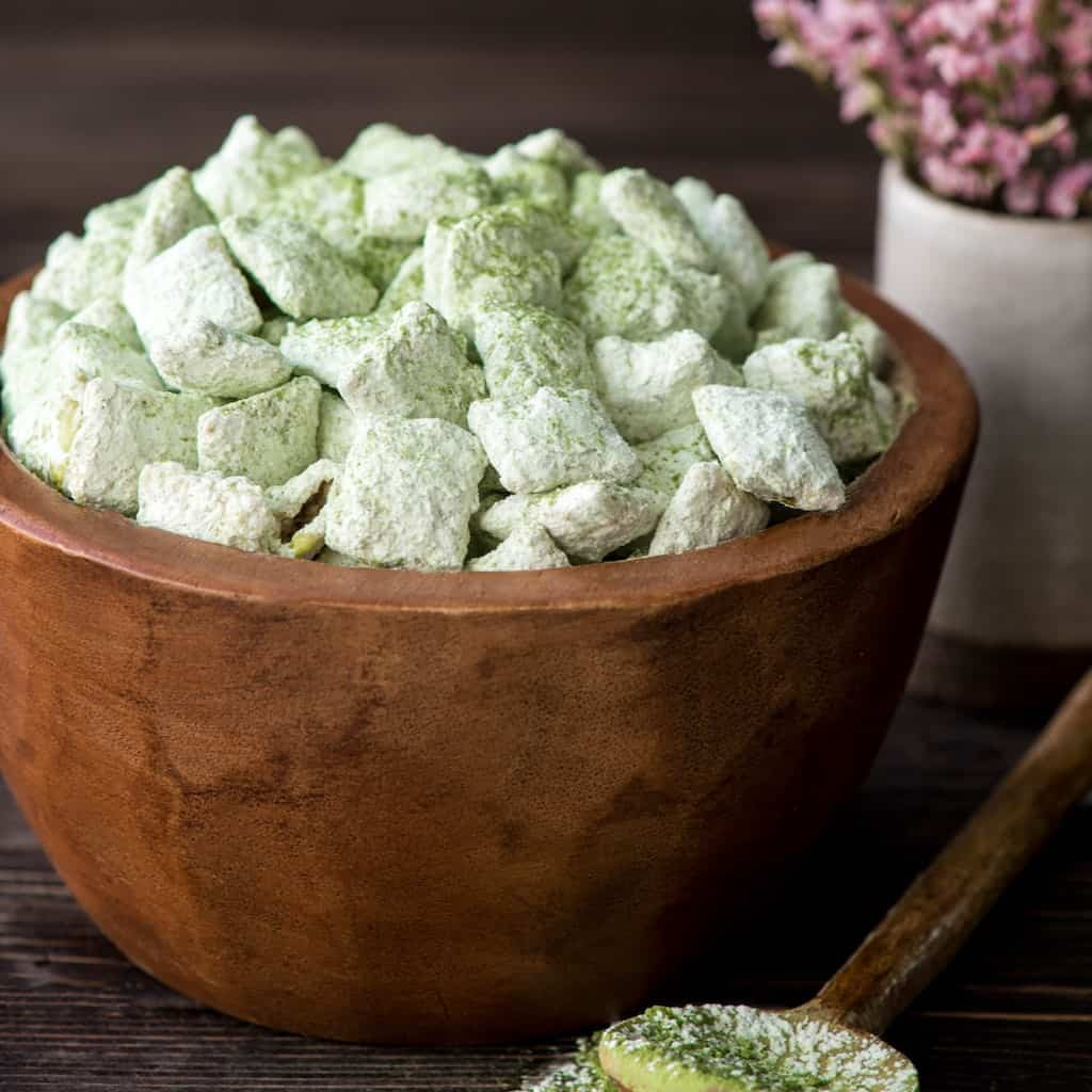 This White Chocolate Matcha Puppy Chow is an easy and fun dessert recipe! Made with only 4 ingredients, its' a unique spin on on a classic! Plus it's naturally green, which makes it the perfect treat for St. Patrick's Day! #matcha #puppychow #whitechocolate #dessert #glutenfree #stpatricksday #naturally green