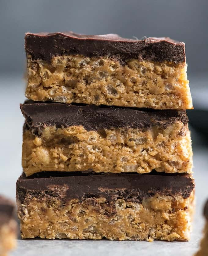 Close-up front view of a stack of three healthy peanut butter rice crispy treats.