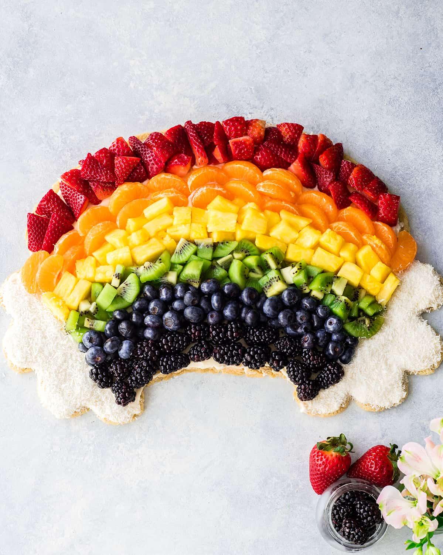 overhead photo of a rainbow fruit pizza
