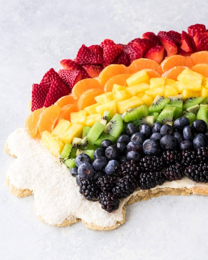 Side view of half of a full rainbow fruit pizza recipe