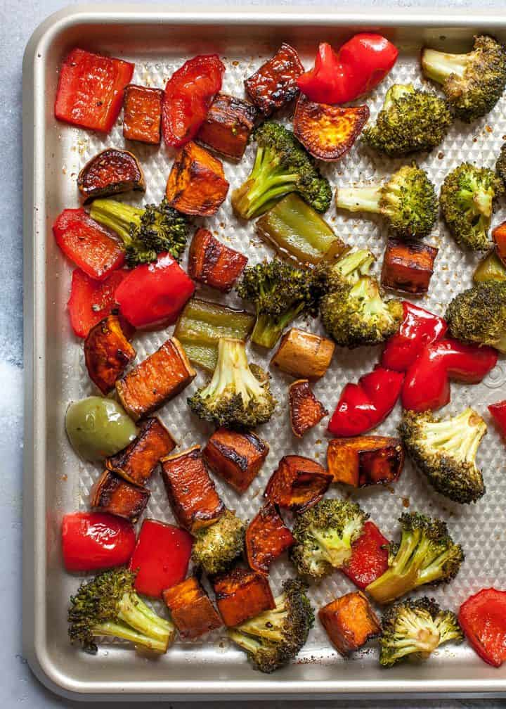 overhead view of balsamic roasted vegetables on a baking sheet