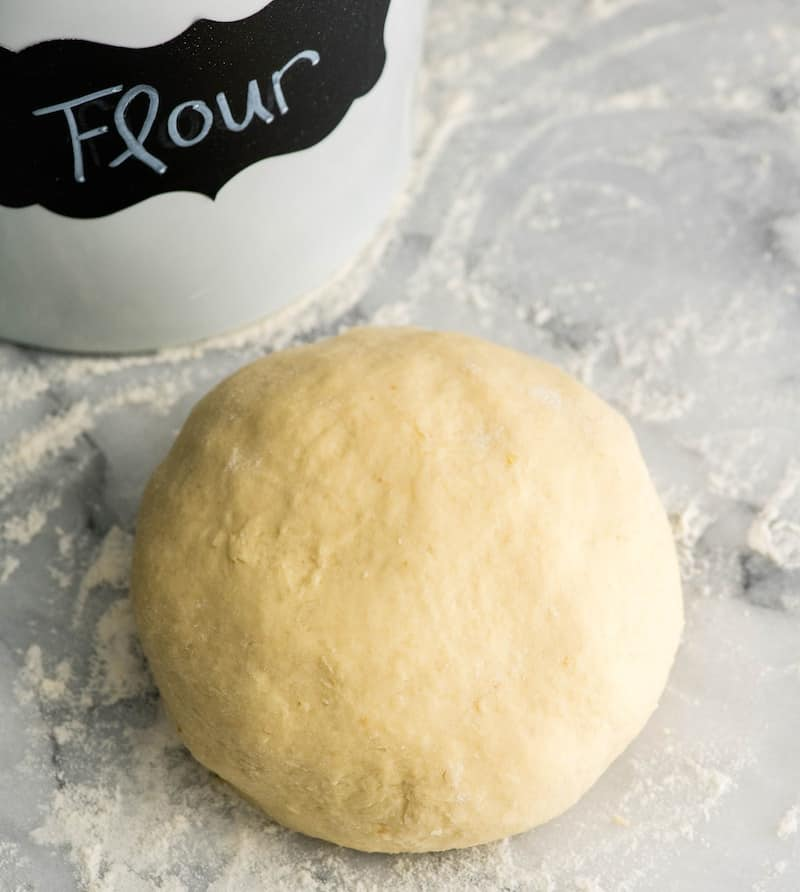 Overhead view of the final dough for Homemade Potato Gnocchi on a floured marble surface