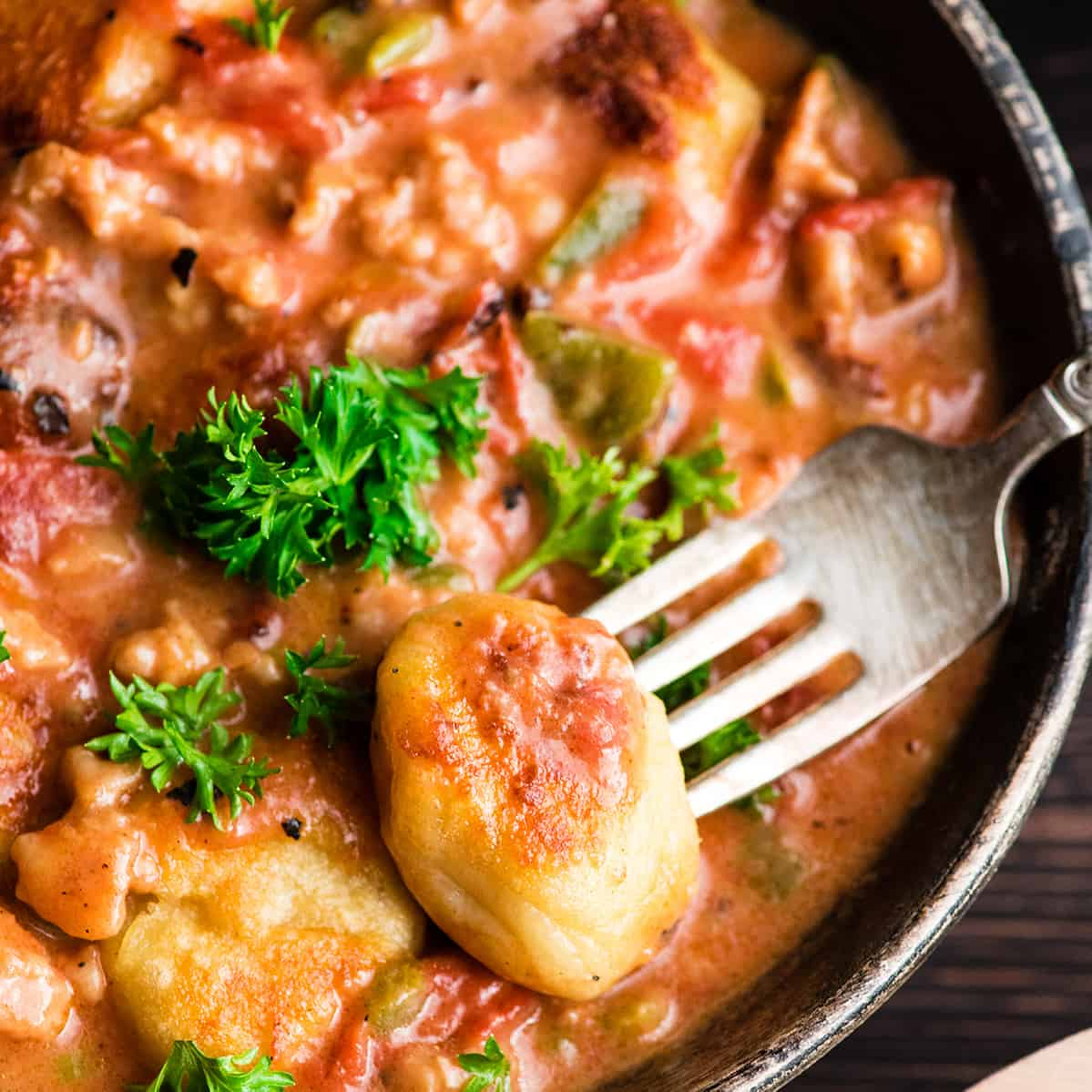 overhead view of a piece of potato gnocchi in sauce