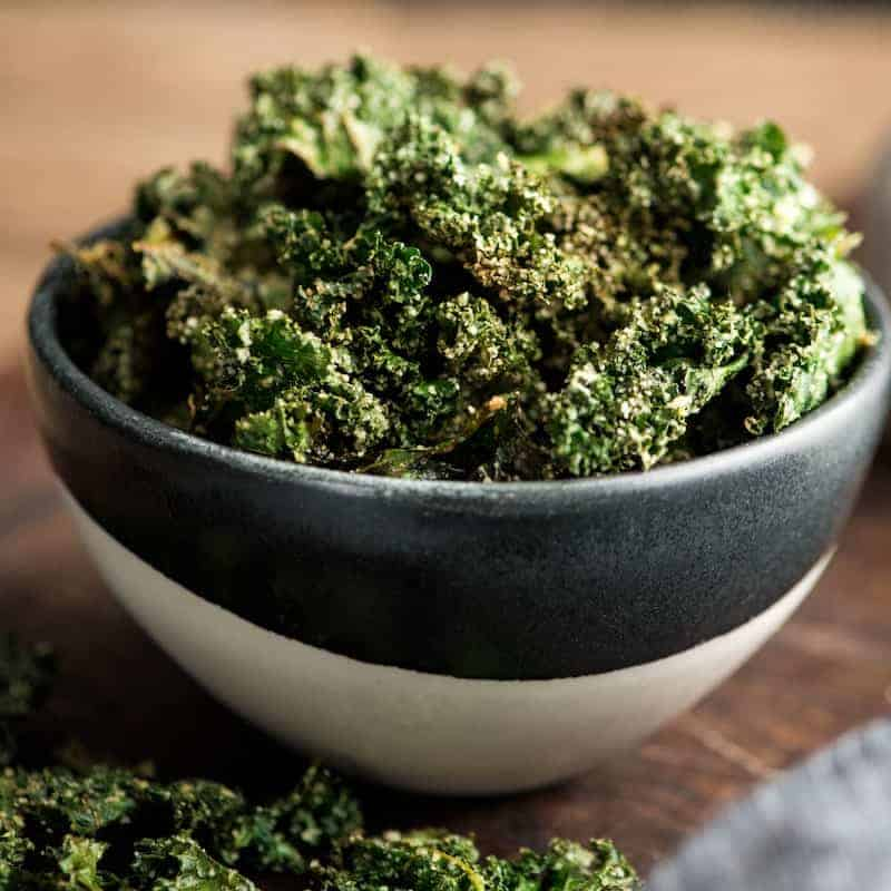 Front view of a bowl of baked kale chips